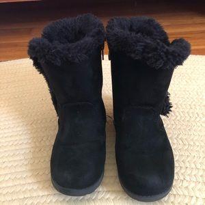 Little girl black fur lined boots.